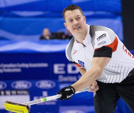 Team Canada's Ben Hebert urges on his teammates. (Photo, World Curling Federation/Céline Stucki)