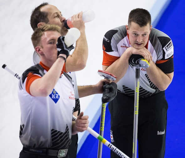 It was a draining, but productive, Sunday for Team Canada's Marc Kennedy, Brent Laing and Ben Hebert. (Photo, World Curling Federation/Céline Stuckli)