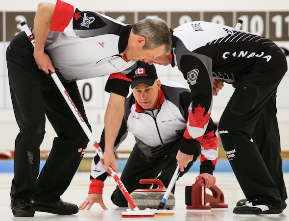 Canadian skip Randy Neufeld watches his rock as sweepers Peter Nicholls, left, and Dale Michie go to work during Friday's win over Sweden. (Photo, World Curling Federation/Céline Stucki)