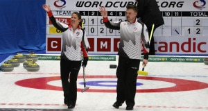 Marliese Kasner and Dustin Kalthoff wave to Canadian fans after a win during the round robin of the 2016 World Mixed Doubles Curling Championship in Karlstad, Sweden (WCF/Richard Gray photo)