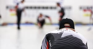 Skip Randy Neufeld looks down the ice as his team delivers the next shot at the 2016 World Seniors Curling Championships in Karlstad, Sweden (WCF/Céline Stucki photo)