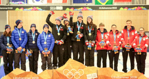 "Karlee Burgess with teammates Mary Fay, Tyler Tardi and Sterling Middleton on the podium at the Youth Olympic Games: ""Nothing in the world could make me happier."" (WCF/Richard Gray photo)"