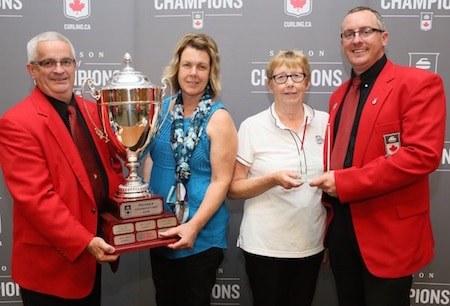 Alberta won the 2015-16 MA Cup, presented by TSN. Governors Ron Hutton, left, and Scott Comfort, right, present the MA Cup to Brenda Asmussen, left, and Joan Westgard of the Alberta Curling Federation. (Photo, Curling Canada/Neil Valois)