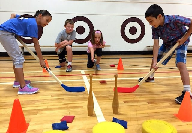 The new PHE Canada Move Think Learn: Focus on Curling resource for teachers includes curling-specific gym activities such as aiming at a target and maintaining balance while throwing. (Photo by Helen Radford)