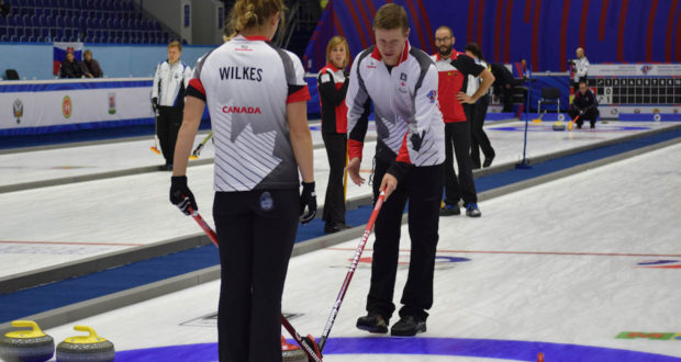 Team Canada skip Mick Lizmore discusses broom placement with third Sarah Wilkes at the 2016 World Mixed Curling Championship in Kazan, Russia (Photo, World Curling Federation/Alina Androsova)