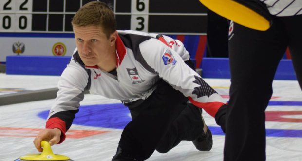 Team Canada skip Mick Lizmore delivers his rock during action at the Kazan Sport Palace during the 2016 World Mixed Curling Championship (Photo World Curling Federation/Alina Androsova)