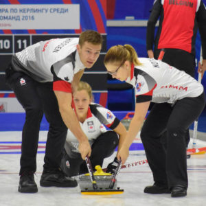 Canada's Brad Thiessen takes a look as he and Alison Kotylak sweep a shot by Sarah Wilkes at the Kazan Sports Palace during round robin play at the 2016 World Mixed Curling Championship (Photo, World Curling Federation/Alina Androsova)
