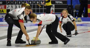 Canada's Brad Thiessen and Alison Kotylak sweep for Sarah Wilkes at the Kazan Sports Palace during action at the 2016 World Mixed Curling Championship (Photo World Curling Federation/Alina Androsova)