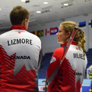 There's lots to smile about as third Sarah Wilkes and skip Mick Lizmore help Team Canada to another win at the Kazan Sports Palace on Monday (Photo, World Curling Federation/Alina Androsova)