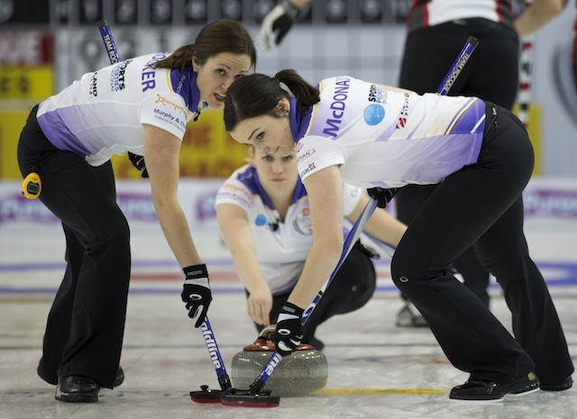 """Taylor McDonald (right) sweeps teammate Jen Gates's rock: """"She's too nice and friendly. I would get a few hits in before she even knew what was going on."""" (Curling Canada/Michael Burns photo)"""