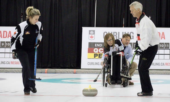Paralympic gold-medallist Sonja Gaudet delivers the ceremonial first rock of the 2016 Travelers Curling Club Championship, with sweepers Sasha Carter and Pat Ryan alongside (Curling Canada photo)