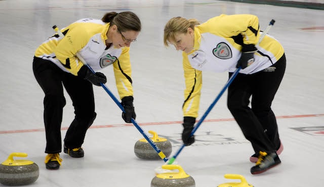 Manitoba second Diana Christensen and lead April Klassen sweep a rock into the house at the 2017 Travelers Curling Club Championship in Kelowna, B.C. (Curling Canada/Jessica Krebs photo)