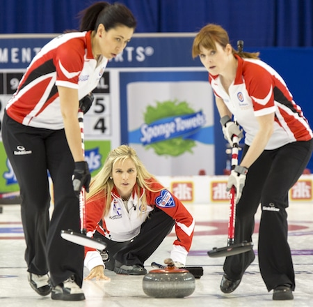 Team Canada Skip Jennifer Jones, Second Jill Officer, Lead Dawn McEwen, in draw seven action at the 2016 Scotties Tournament of Hearts, the Canadian Womens Curling Championships, Grande Praire, Alberta