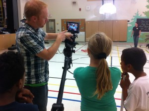 Kaitlyn Lawes looks on as a new Rocks & Rings television commercial is being recorded.