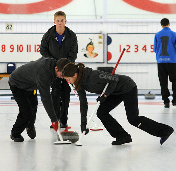 Canada's 2012 Youth Olympics curling team in action at OVCA Junior Superspiel