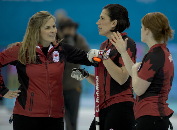 From left, Team Canada's Jennifer Jones, Jill Officer and Dawn McEwen share a light moment during Monday's win over South Korea. (Photo, CCA/Michael Burns)