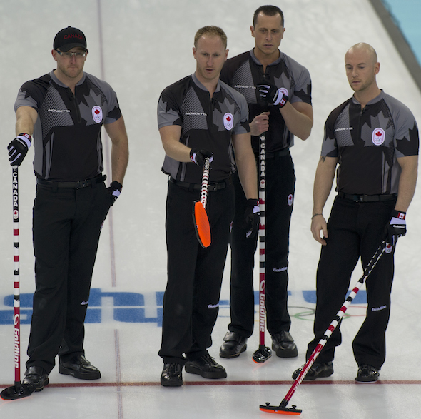 Team Canada, from left, Ryan Harnden, Brad Jacobs, E.J. Harnden and Ryan Fry discuss options in the 10th end. (Photo, CCA/Michael Burns)