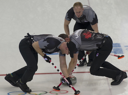 Team Canada skip Brad Jacobs, top, instructs sweepers Ryan Harnden, left, and E.J. Harnden. (Photo, CCA/Michael Burns)