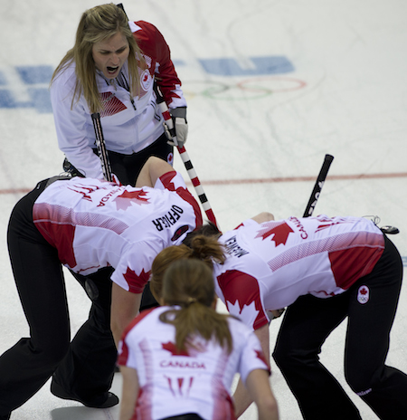 Team Canada works on the game-winning draw by Jennifer Jones on Wednesday.