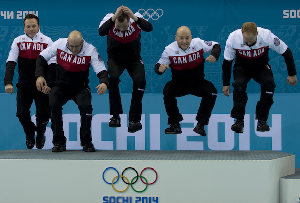 Team Canada, from left, Caleb Flaxey, Ryan Harnden, E.J. Harnden, Ryan Fry and Brad Jacobs jump to the top of the podium in Sochi. (Photos, CCA/Michael Burns)