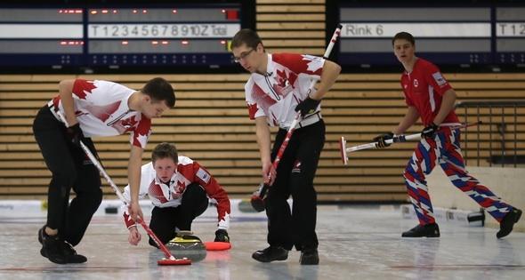 Canadian skip delivers a rock to his sweepers Lukas Van Den Bosch and  Brendan Wilson (Photo WCF/Richard Gray)