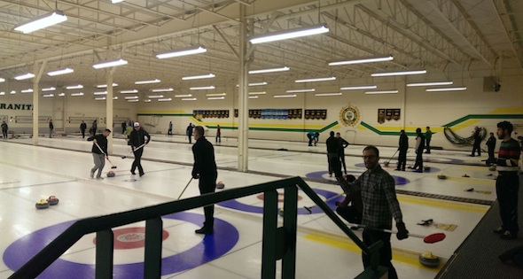 Action on the ice at Edmonton's Granite Club during Curling with Pride's league play (Photo James Fox)