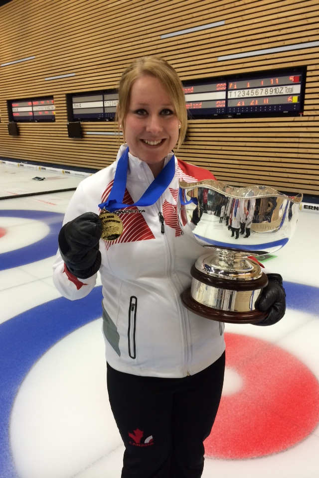 Keely Brown shows off her medal and trophy after the gold medal game at the 2014 World Junior Curling Championships (Photo courtesy K. Brown)