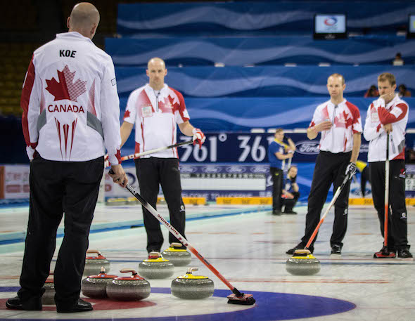Team Canada ponders its situation during Saturday's semifinal loss to Sweden.  (Photo, World Curling Federation / Céline Stucki)