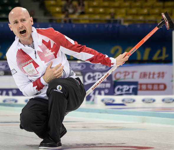 Team Canada skip Kevin Koe instructs his sweepers during the bronze-medal game. (Photo, World Curling Federation / Céline Stucki)