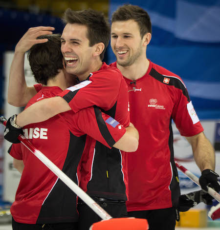 Team Switzerland celebrates its bronze medal on Sunday. (Photo, World Curling Federation / Céline Stucki)