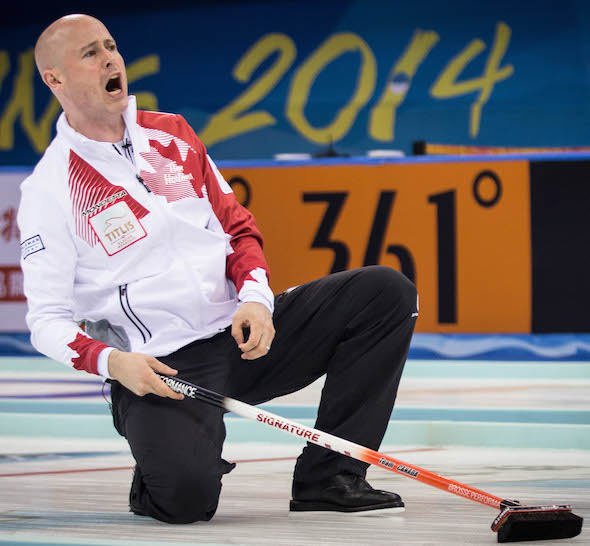 Team Canada skip Kevin Koe instructs his sweepers during Wednesday's loss to Sweden. (Photo, World Curling Federation / Céline Stucki)