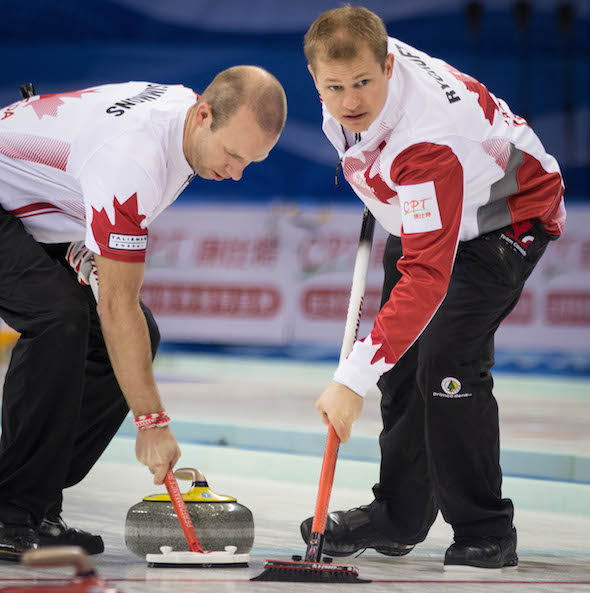 Canadian sweepers Pat Simmons, left, and Carter Rycroft keep things clean. (Photo, World Curling Federation / Céline Stucki)