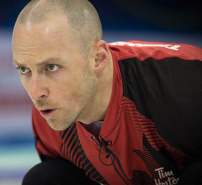 Team Canada's Nolan Thiessen concentrates on his shot during Saturday's loss to Norway. (Photo, World Curling Federation / Céline Stucki)