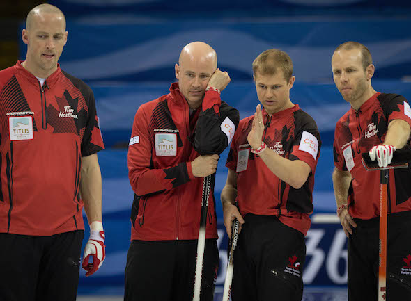 Team Canada ponders its options during Saturday's Page playoff game. (Photo, World Curling Federation / Céline Stucki)