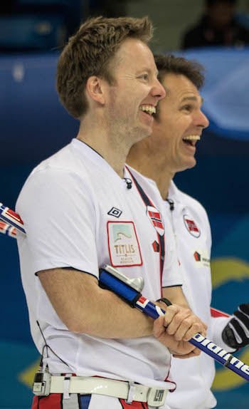 Norway's Thomas Ulsrud, left, and Torger Nergård share a laugh on Saturday. (Photo, World Curling Federation / Céline Stucki)