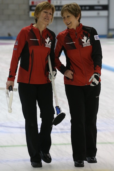 Canadian second Shelley MacNutt shares a laugh with skip Colleen Pinkney at the 2014 World Senior Curling Championships  in Dumfries, Scotland (Photo WCF/Richard Gray)