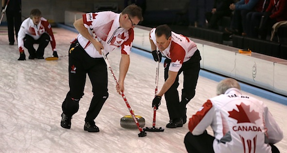 Skip Wayne Tallon calls the line on second Mike Flannery's shot as sweepers Wade Blanchard and Mike Kennedy work hard at the 2014 World Senior Curling Championships in Dumfries, Scotland (Photo WCF/Richard Gray)