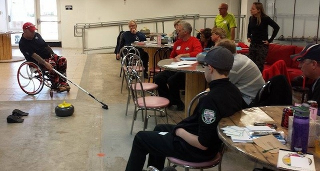 Saskatchewan's Dustin Mikush attends a session on wheelchair curling from US Paralympic skip, Patrick McDonald (Photo courtesy D. Mikush)