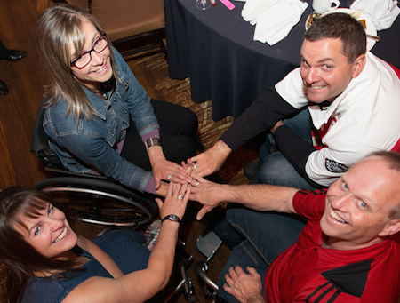 Wheelchair Curling's Ina Forrest, Sonja Gaudet, Mark Ideson and Dennis Thiessen show off their Paralympic Rings during the Celebration of Excellence Paralympic Ring Reception in Calgary. (Photo: Matthew Murnaghan/Canadian Paralympic Committee)