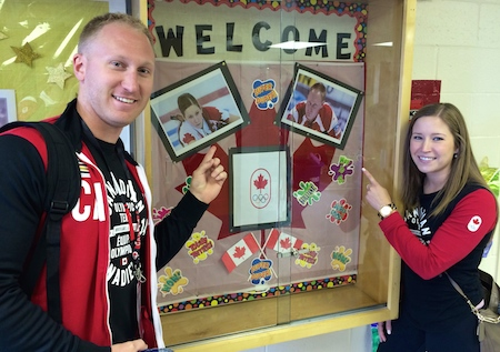 Brad Jacobs and Kaitlyn Lawes were welcomed warmly at St. Anthony's School in Calgary on Thursday. (Photo, CCA)