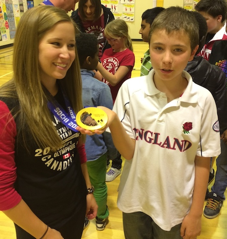 A student at St. Anthony's School in Calgary finds out just how heavy those Olympic gold medals really are! (Photo: CCA)