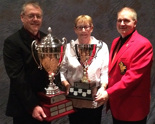 (From left) Dan Kleinschroth, past-president of the Alberta Curling Fed., Joan Westgard, current president of the ACF, and Hugh Avery, Chair of the CCA Board of Governors with the MA Cup, presented by TSN, and the Governors' Cup. (CCA Photo)